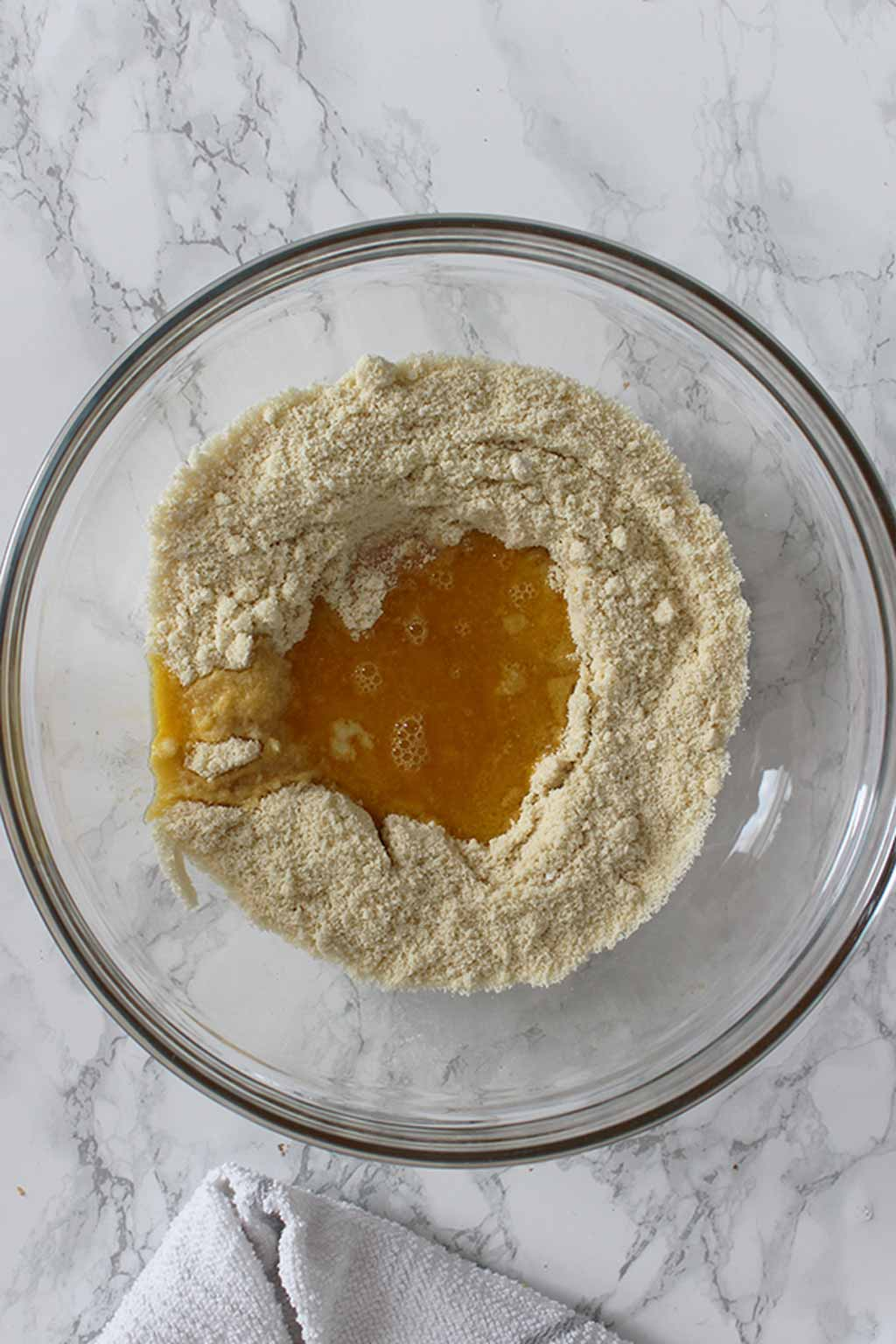 Bowl Containing Almond Flour And Melted Butter