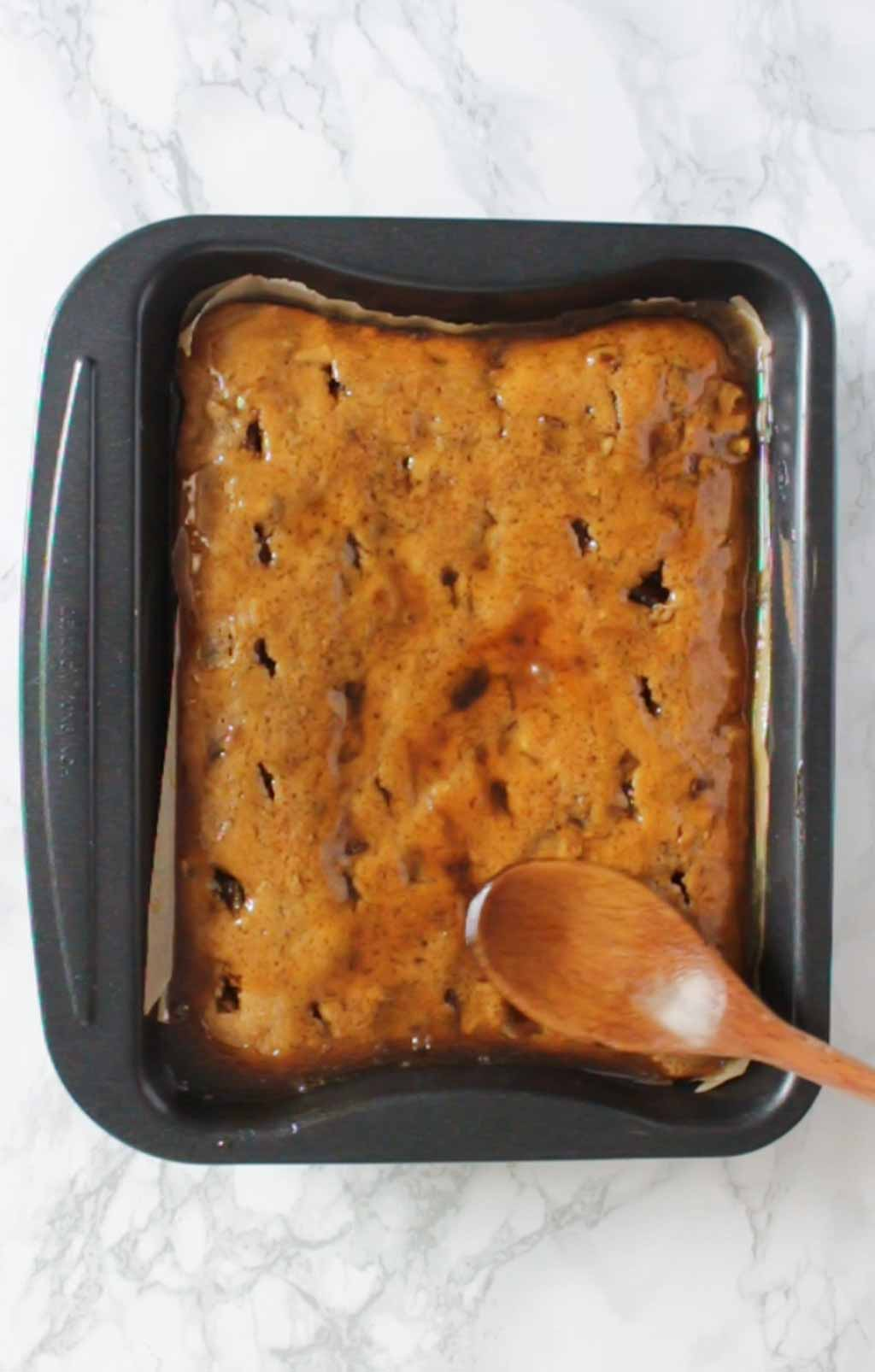 Spreading Toffee Sauce Over Pudding