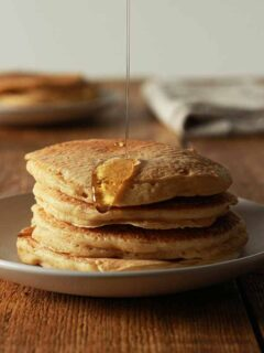 Thumbnail image of a stack of pancakes with syrup dripping down them