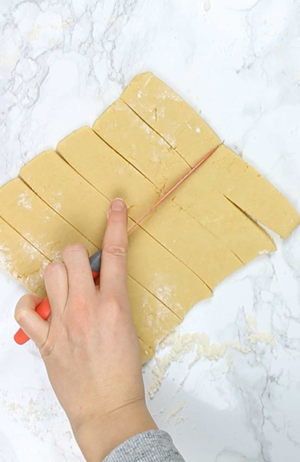 cutting dough into fingers