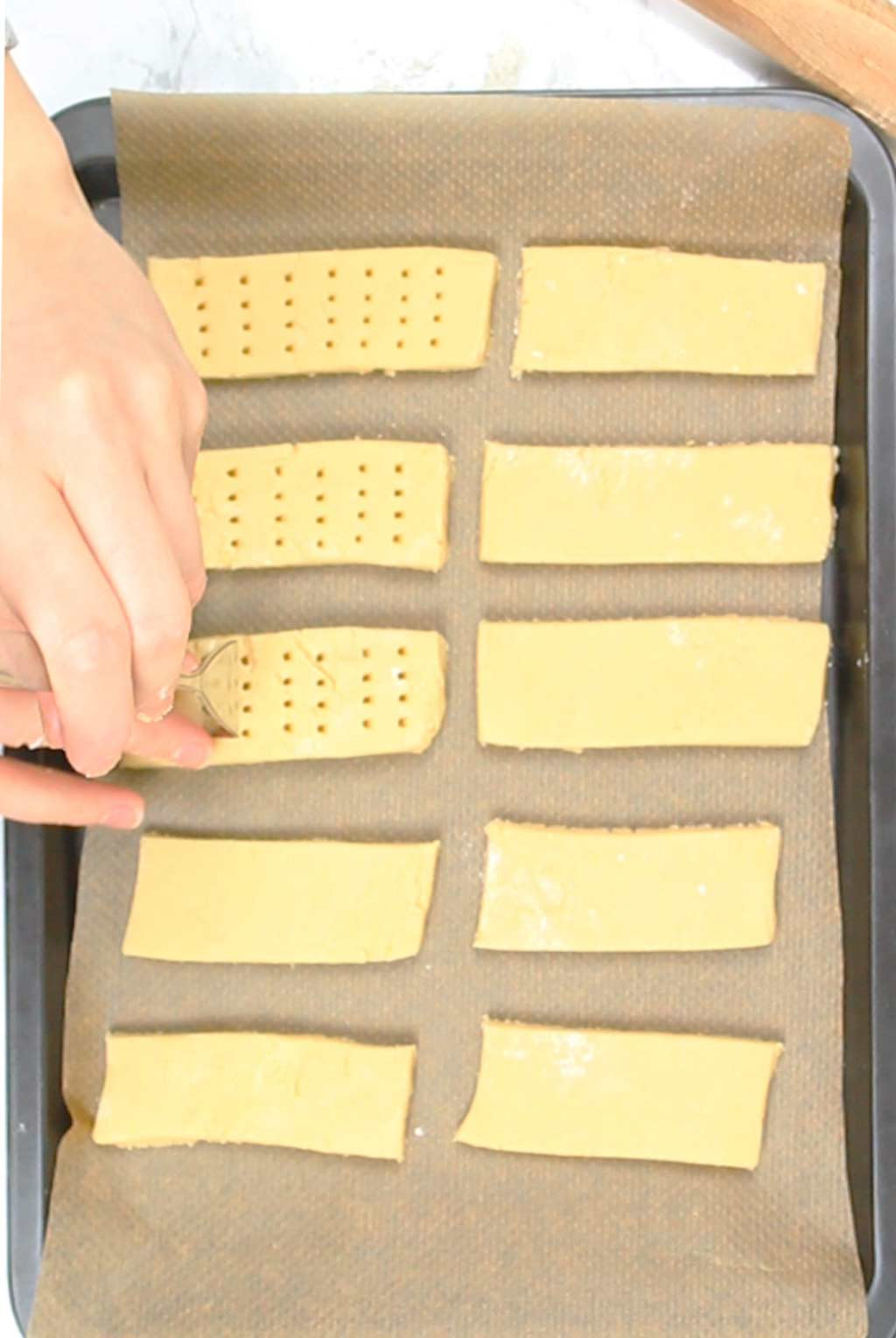 docking the shortbread fingers using a fork