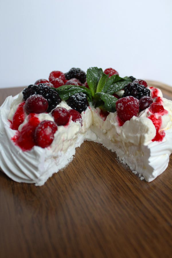 vegan pavlova with a slice taken out