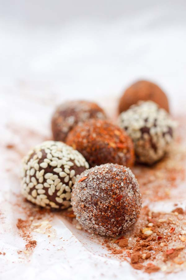 six chocolate truffles on a board