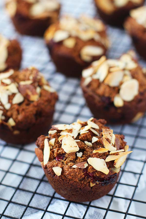 muffins topped with almond flakes on a wire rack