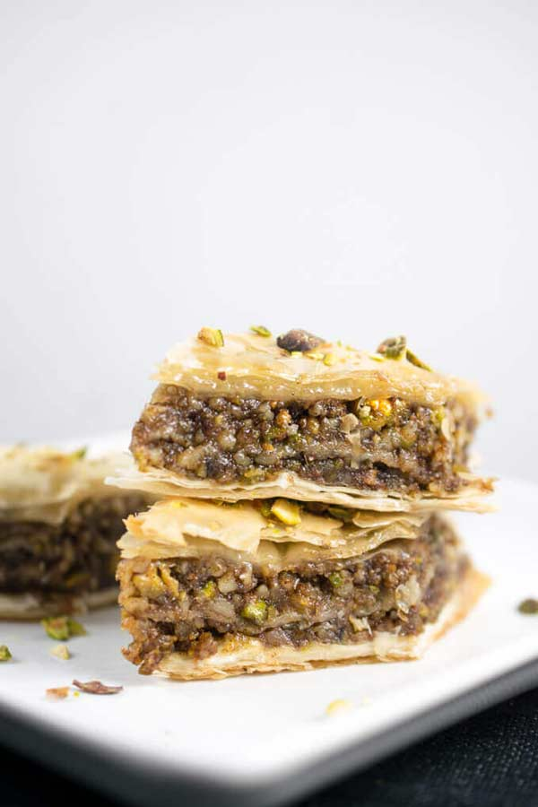 Two pieces of baklava stacked on top of one another