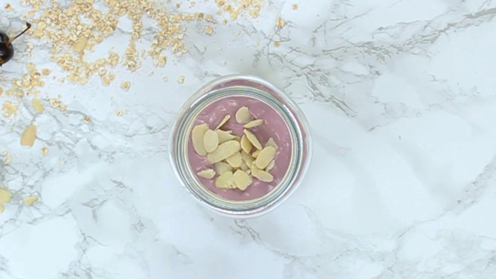 overnight oats with yogurt and sliced almond on top
