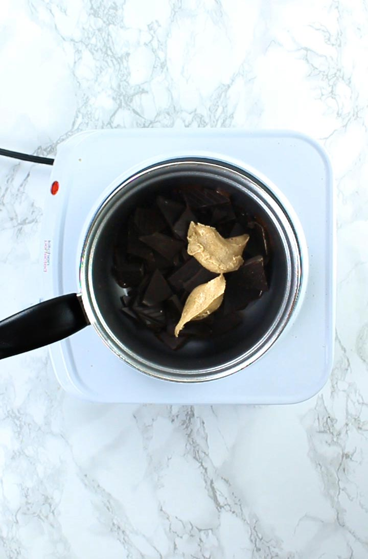 Peanut butter and chocolate in a pot before melting