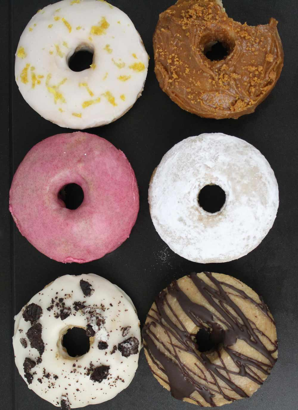 6 donuts on a tray