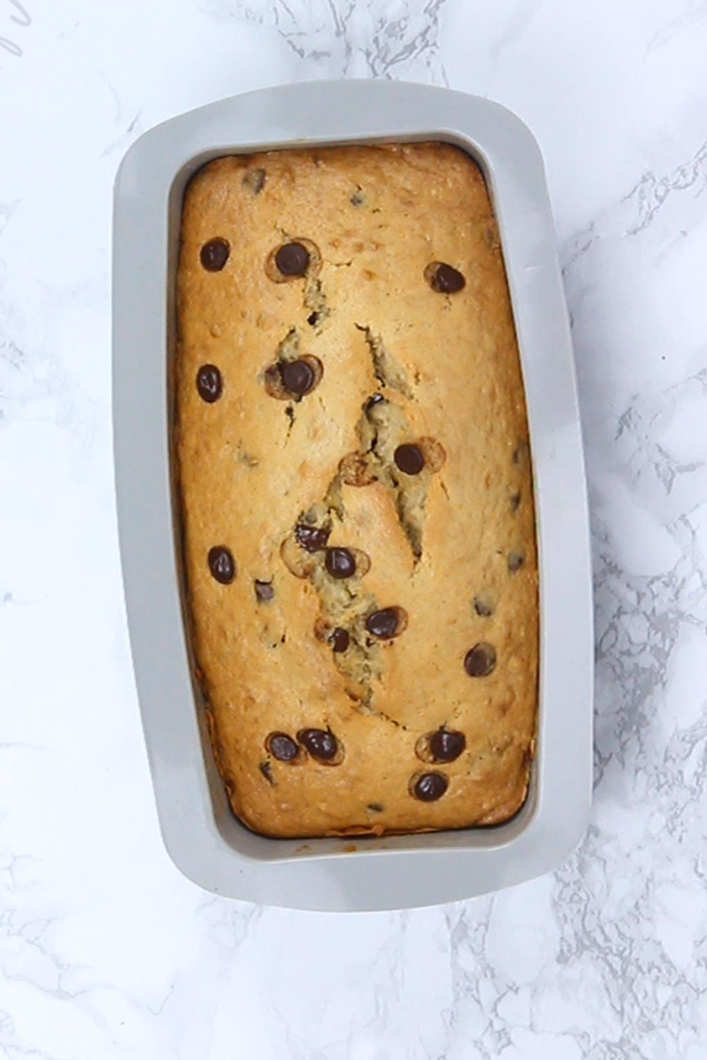 baked chocolate chip banana bread in the loaf tin