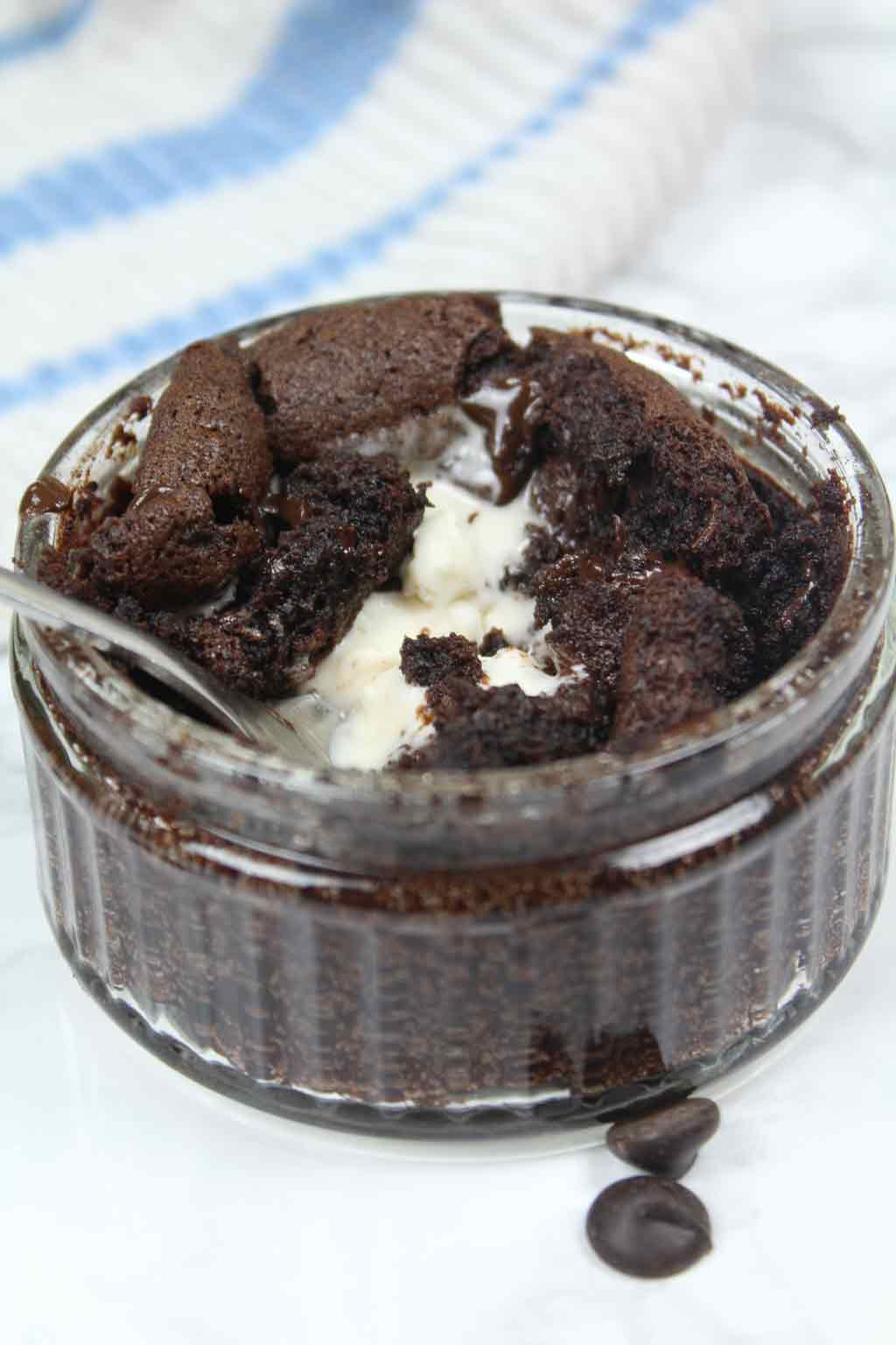 half eaten mug brownie with melted ice cream in the center