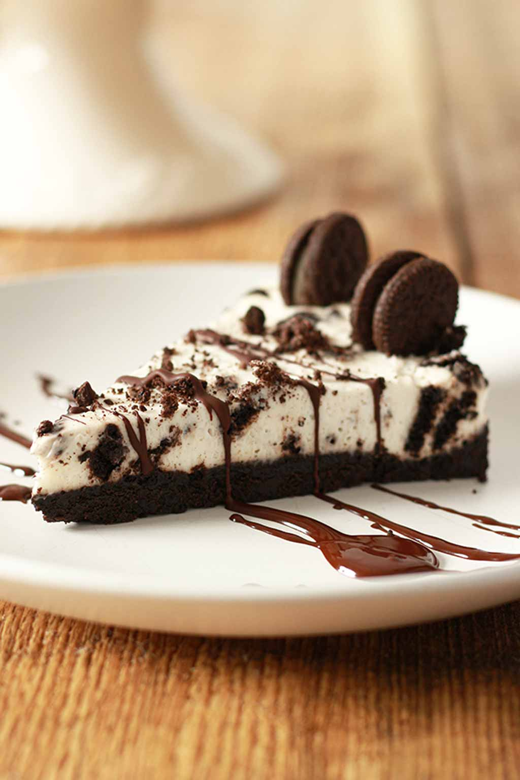 Slice Of Oreo Cheesecake On A White Plate