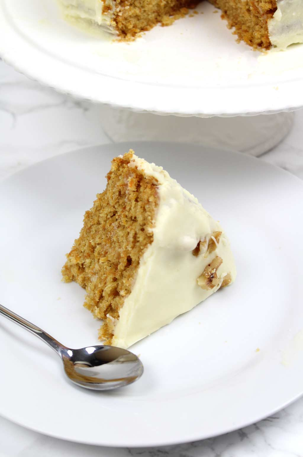 a slice of vegan carrot cake on a plate