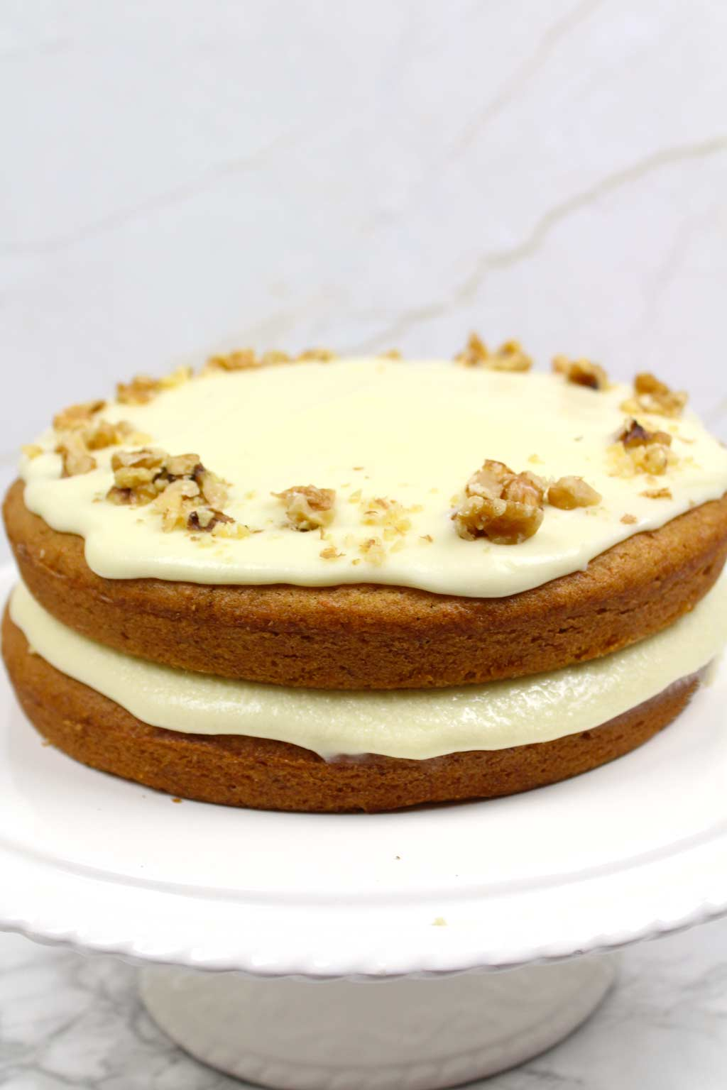 vegan carrot cake on a cake stand