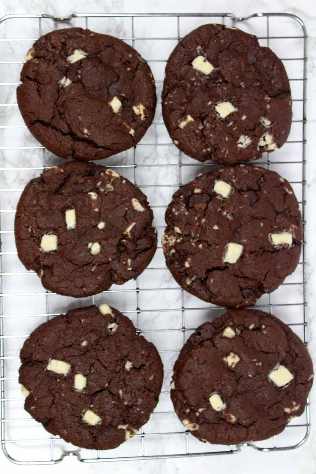 6 vegan double chocolate chip cookies on a cooling rack