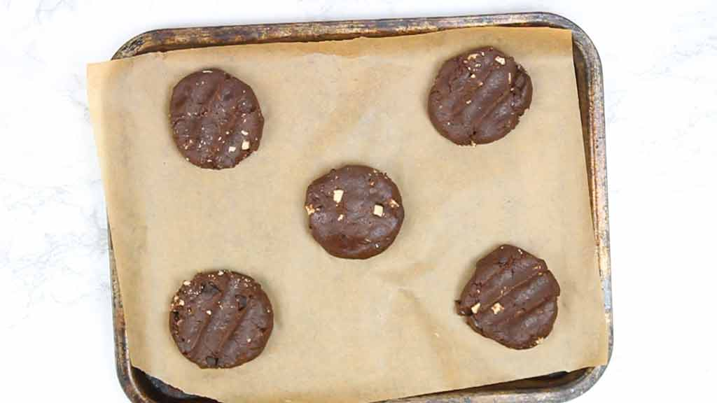 raw cookies on a tray waiting to be baked