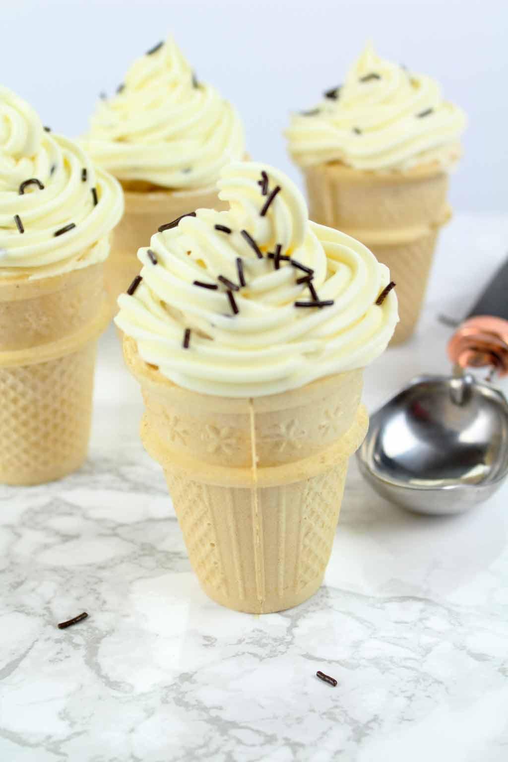 Ice cream cone cupcakes beside an ice cream scoop