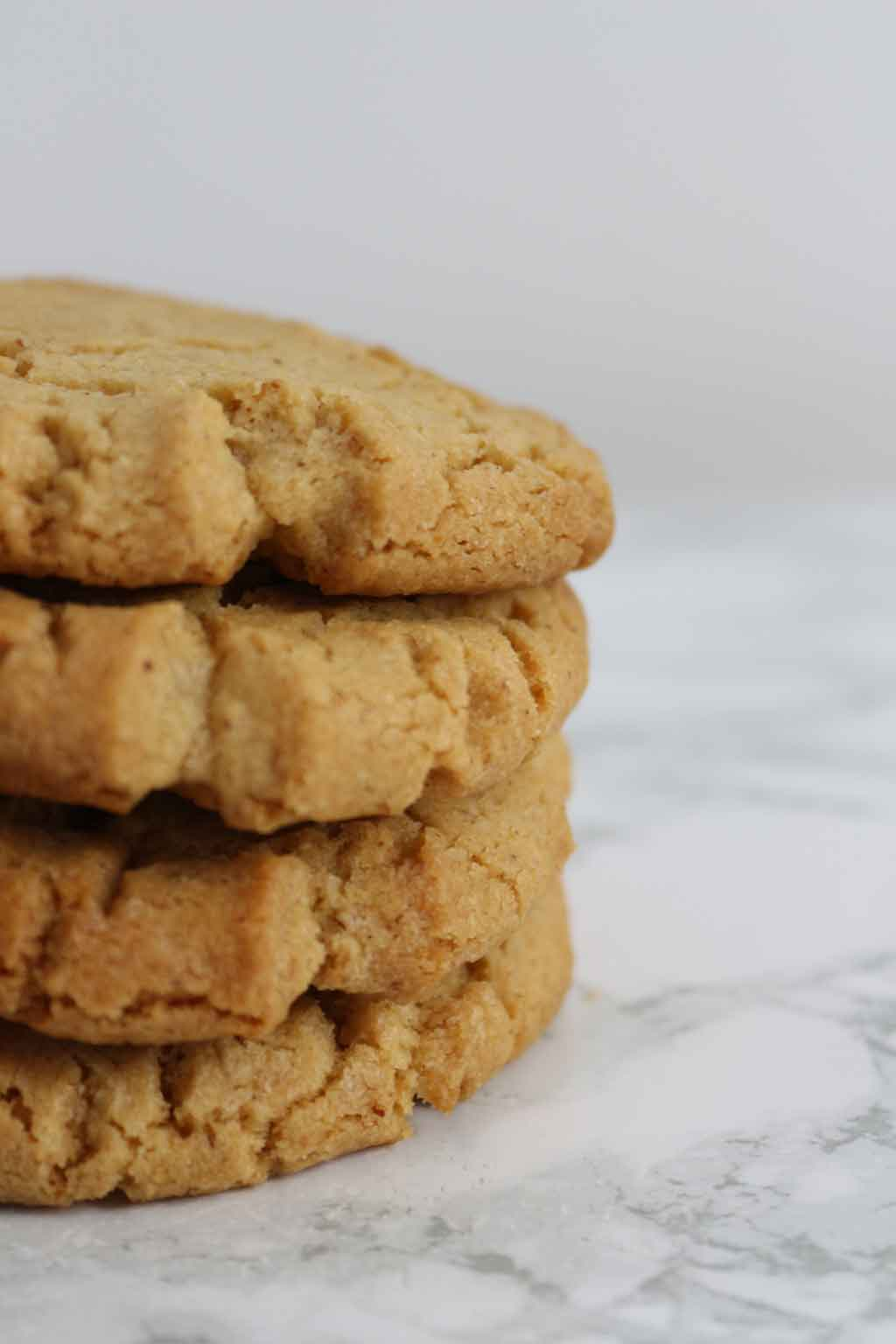 close up of a stack of 4 cookies