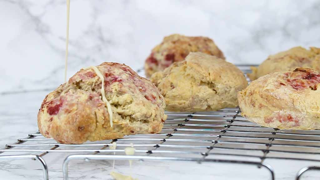 drizzling white chocolate over the baked scones