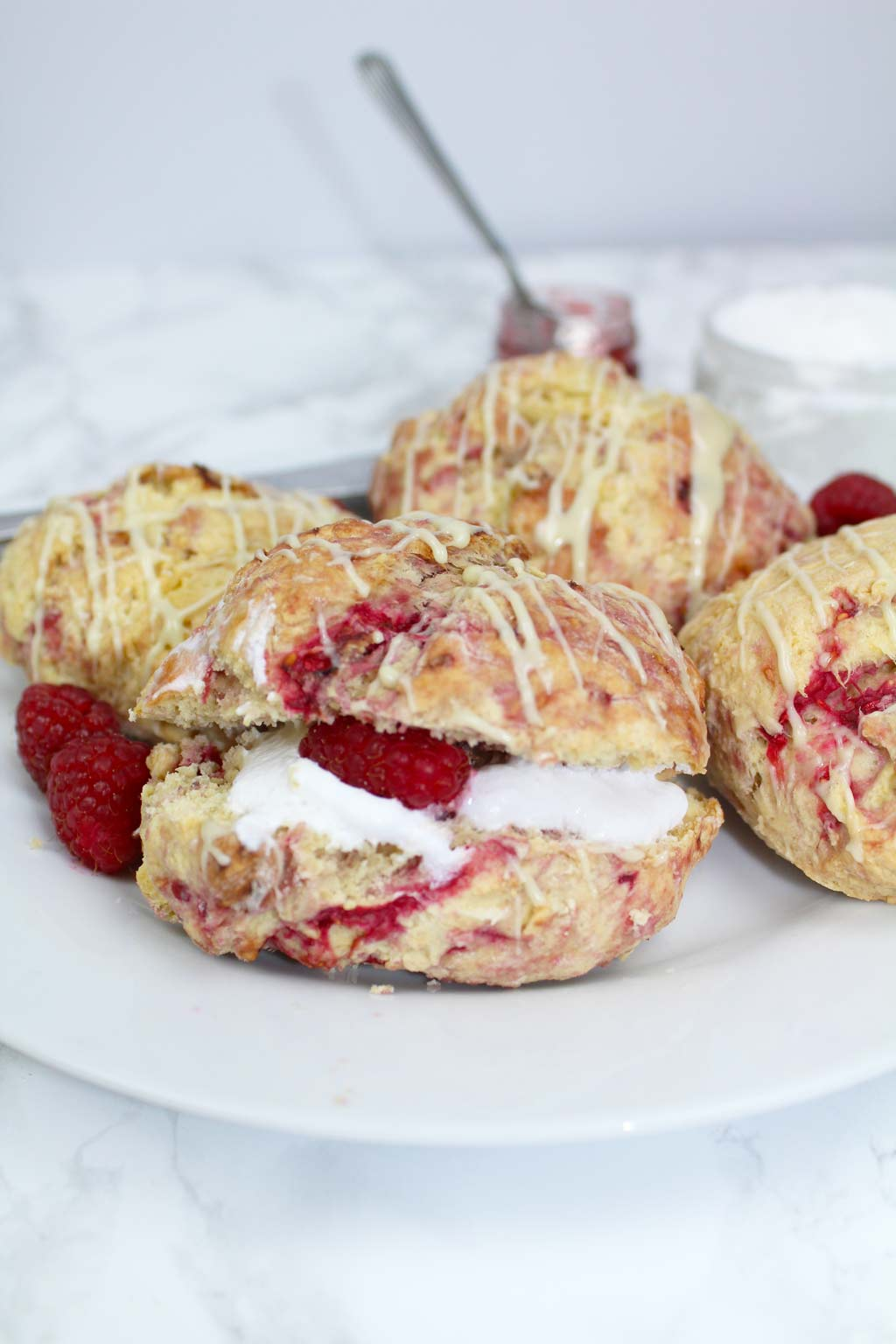 scones on a plate filled with cream