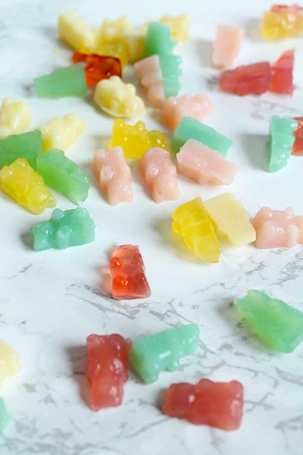 vegan gummy bears scattered on worktop