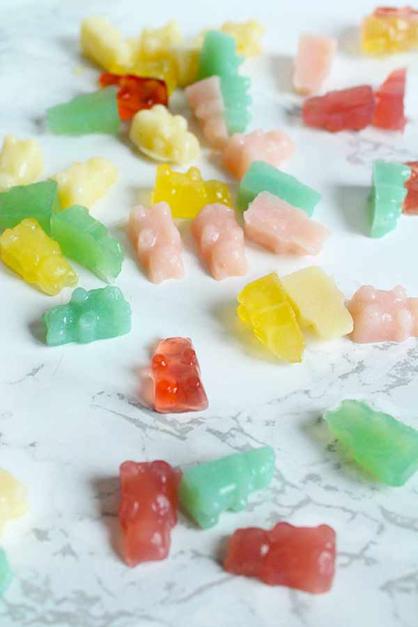 vegan gummy bears scattered on a work top