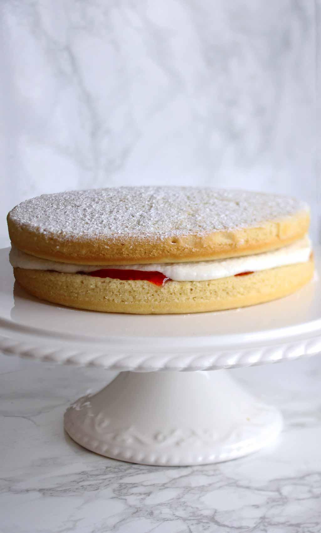 Vegan Victoria Sponge on a cake stand