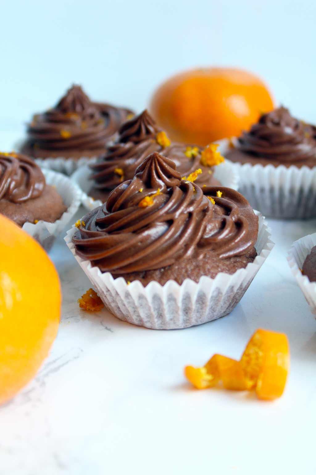 vegan chocolate orange cupcakes and two oranges
