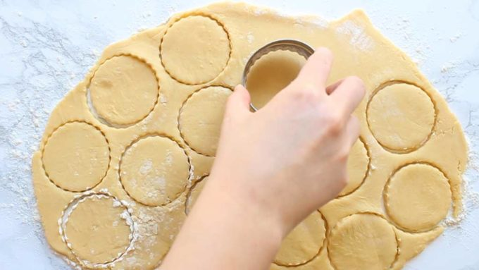cutting cookie shapes out of the dough