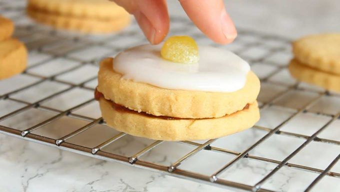 putting a Jelly Tot on top of the biscuits