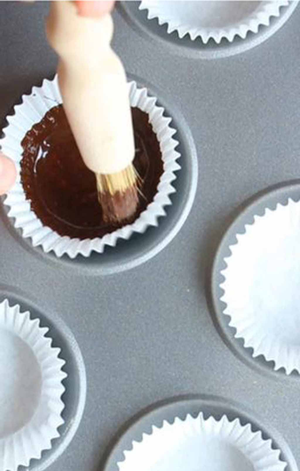 Painting Chocolate Onto The Paper Case With A Pastry Brush