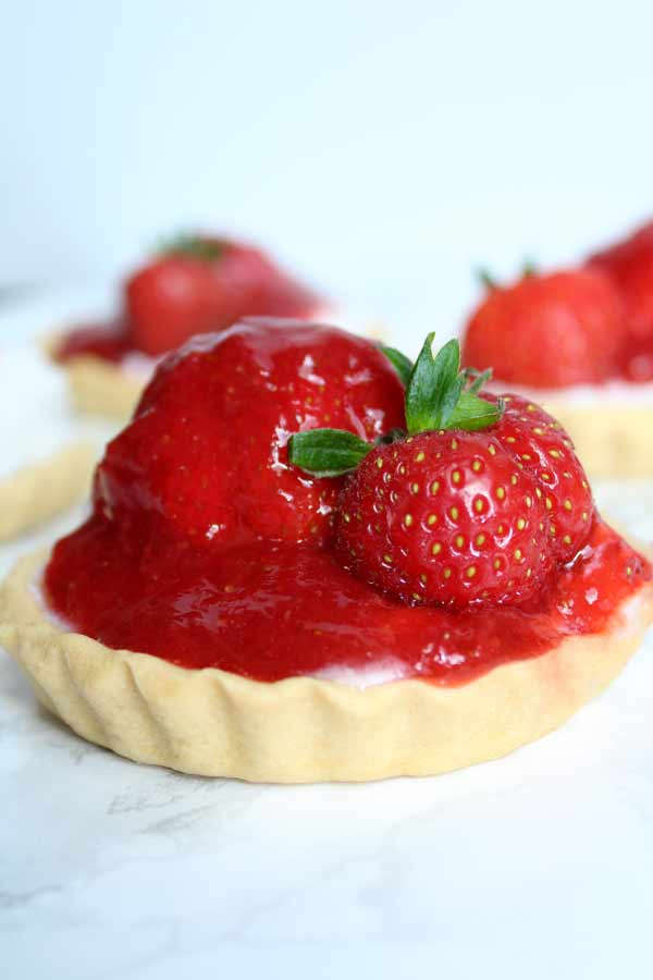 mini strawberry tart with a strawberry on top