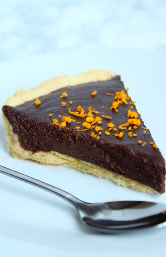 a slice of chocolate orange tart on a plate