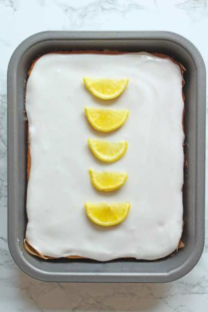 vegan lemon elderflower cake with lemon slices on top