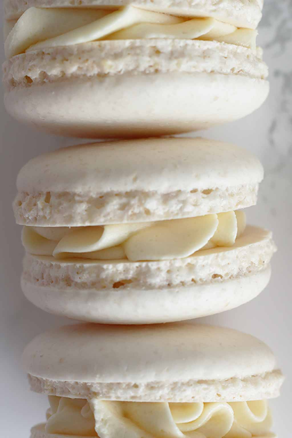 3 white Macarons on their side