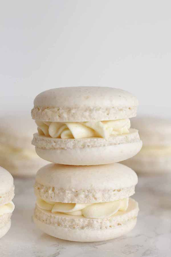 thumbnail image of 2 white macarons on top of one another