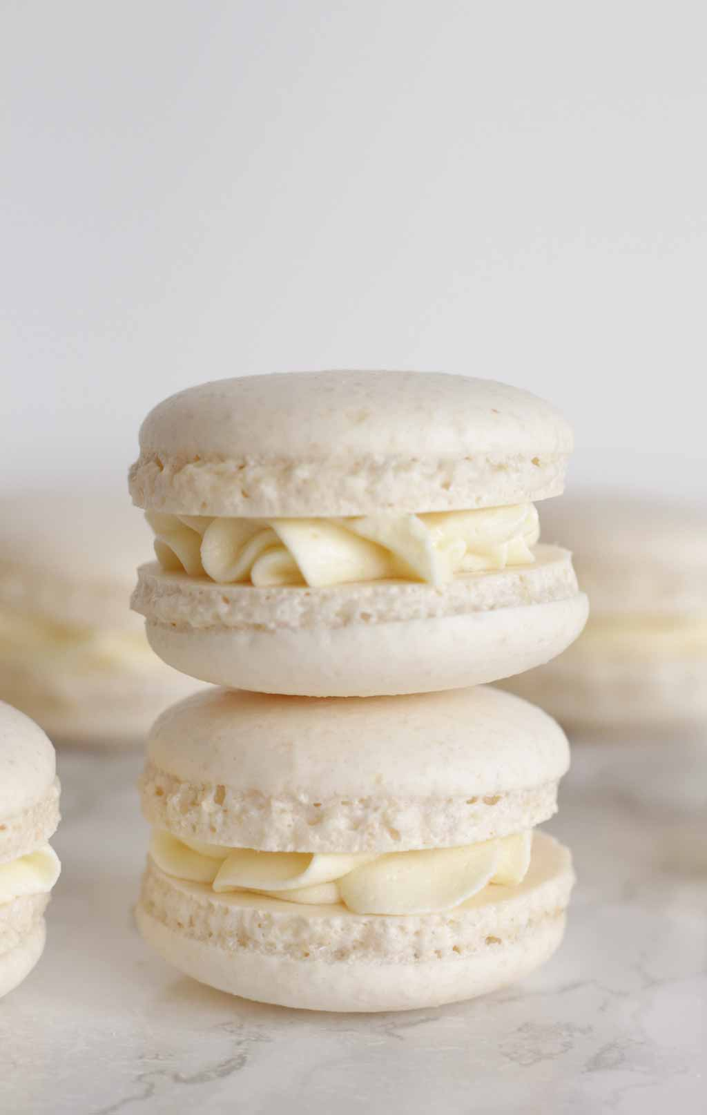Two White Macarons Stacked On Top Of One Another