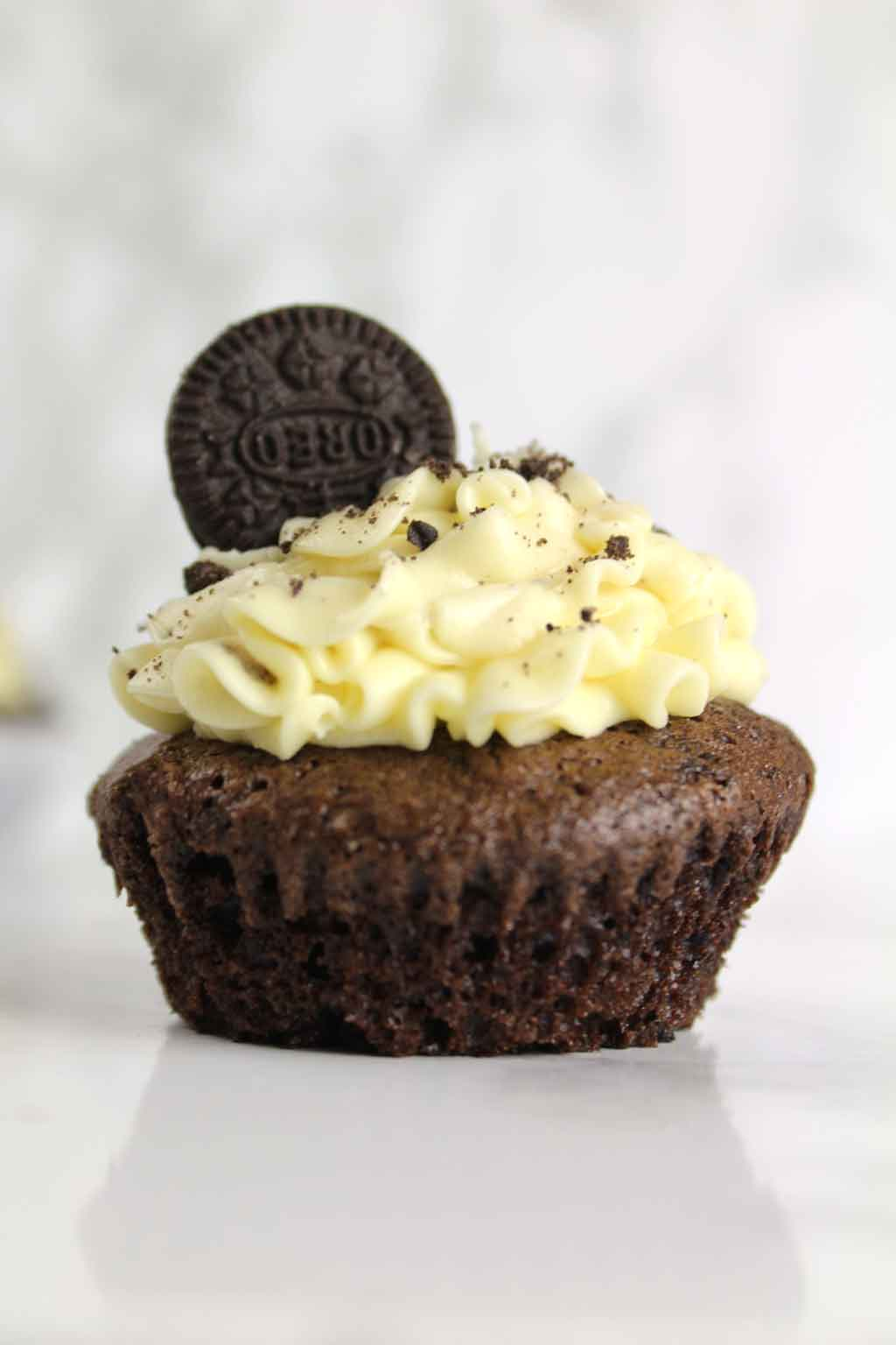 a vegan Oreo cupcake with the wrapper taken off