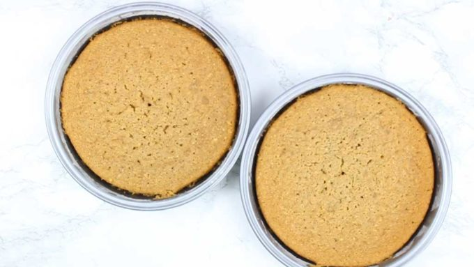 two baked coffee cakes in their tins, side by side