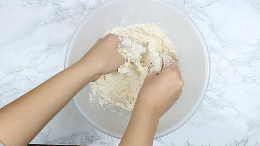 rubbing butter into the flour to make pastry dough