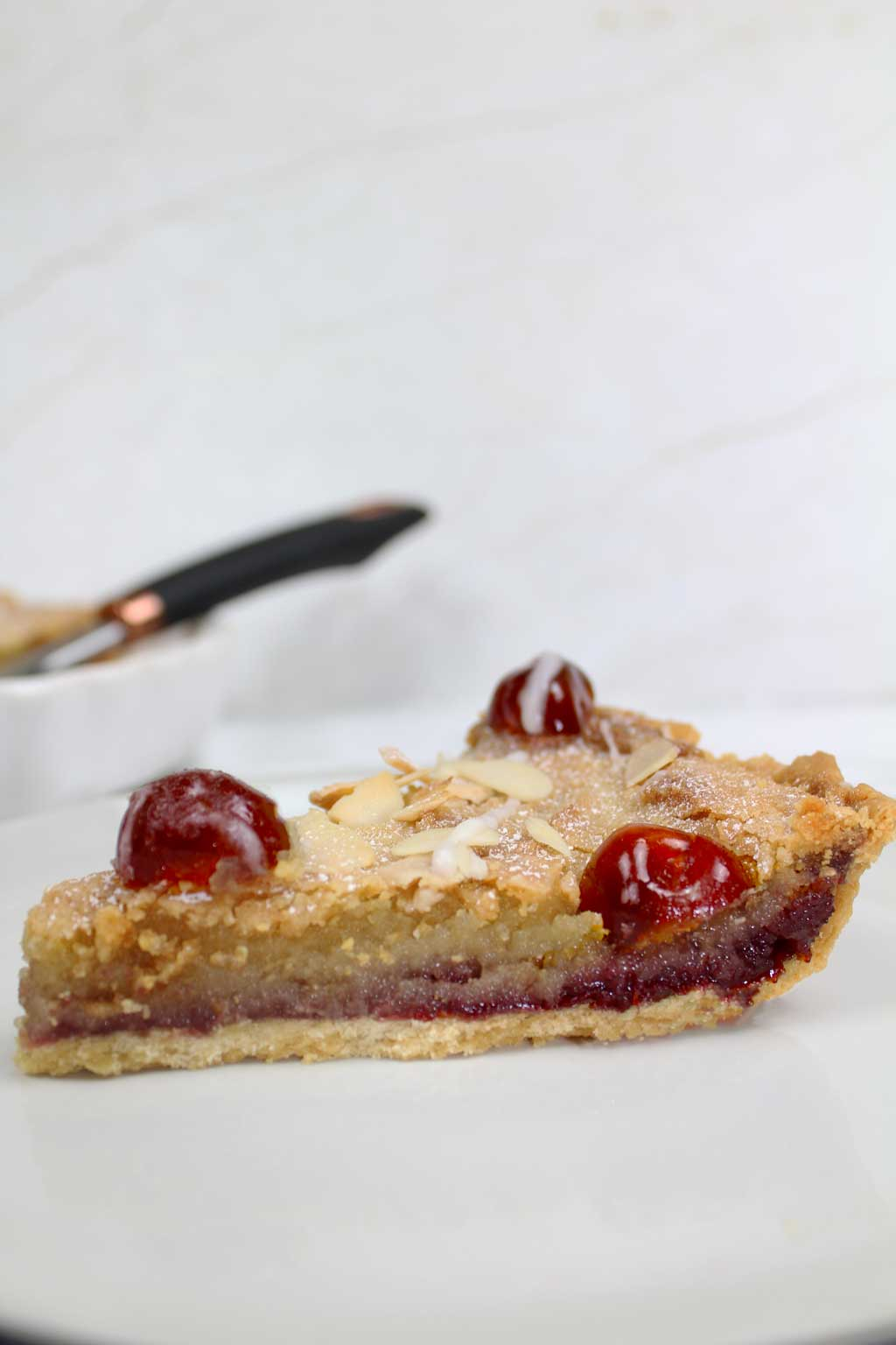 a slice of vegan bakewell tart