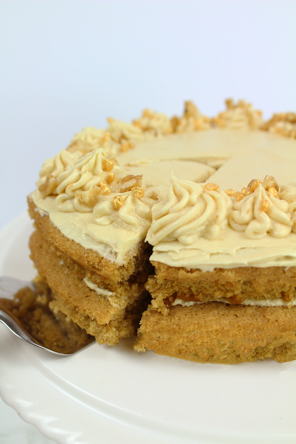 vegan coffee cake with a slice being taken out of it