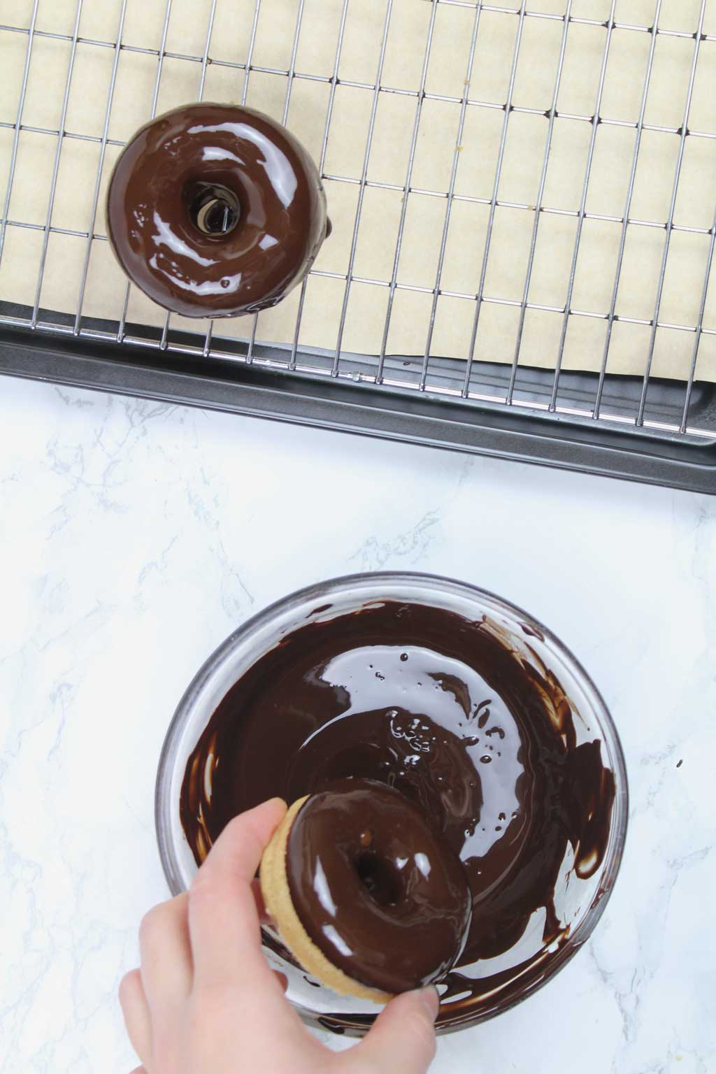 dipping donuts into melted chocolate