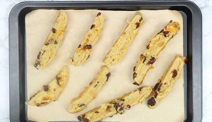 slices of biscotti on a baking tray