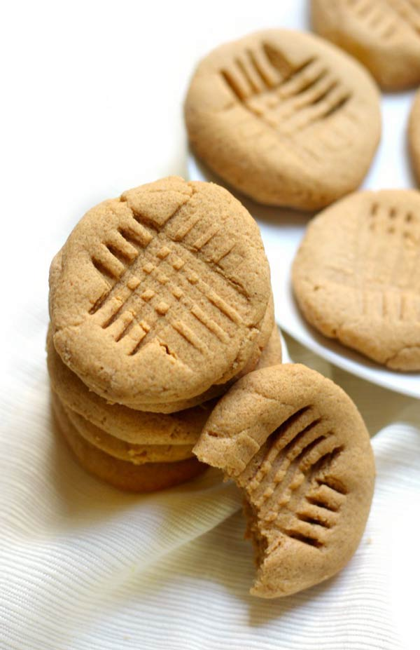 stack of sugar free peanut butter cookies with criss cross shapes in the middle