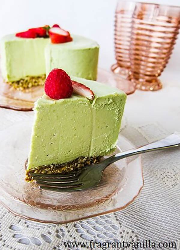 a slice of key lime cheesecake on a plate