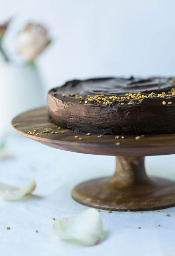 raw chocolate cake on a cake stand