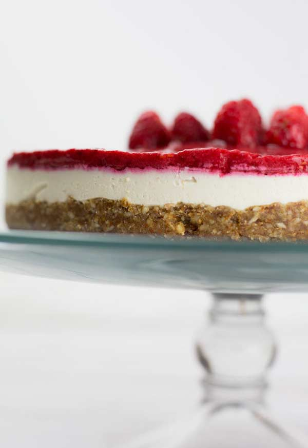 close up of raspberry cheesecake on a cake stand