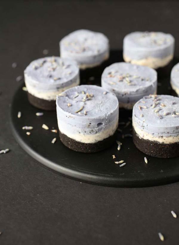 6 mini purple cheesecakes on a black plate