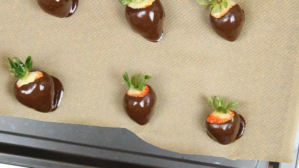 chocolate covered strawberries on a line baking tray