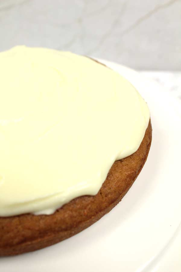 vegan cream cheese frosting on a single layer cake